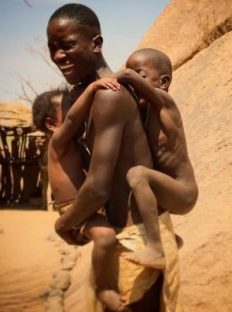 A young man of the Damaraland Tribe with his niece and nephew